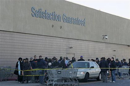 Shoppers wait to be let back into the Wal-Mart