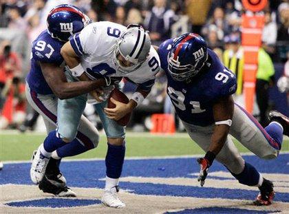 The Giants' Mathias Kiwanuka and Justin Tuck sack Tony Romo