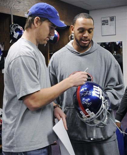 Eli signs a helmet for practice squad tight end Martrez Milner