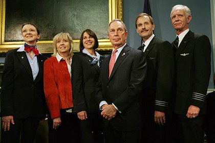 The Flight 1549 crew—Donna Dent, Doreen Welsh, Sheila Dail, Jeffrey Skiles and Chesley Sullenberger—flank Mayor Bloomberg