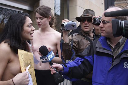 The Feminist Ninjas lend their support while topless.