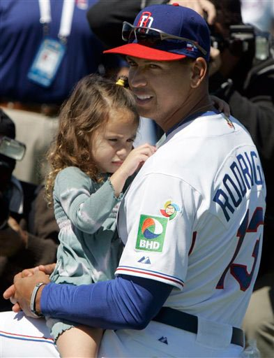 Natasha Rodriguez is held by daddy A-Rod