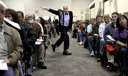 Bidder's assistant Jeff Johnston keeps things going during the foreclosed home auction at the Javits Center