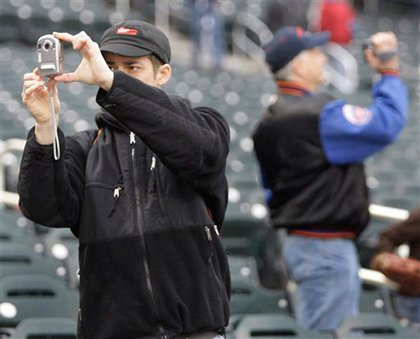 Fans take photos