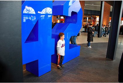 A young fan poses with Jackie Robinson's number