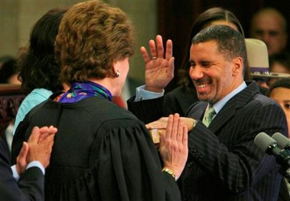 """With Spitzer's resignation, the spotlight shifted to his lieutenant governor, David Paterson.  A legally blind, popular State Senator from Harlem, Paterson was thrust into the spotlight and said at his inauguration, """"I can believe we can weather the storm, I've worked for New Yorkers my whole life. I don't know the path yet because we haven't blazed the trail, and I think you all know I know a little something about finding my way in the dark.""""  Then, in apparent pre-emptive strikes against the media, he and his wife revealed they each had extra-marital affairs and Paterson admitted to using cocaine.  The """"accidental governor"""" warned about the state's economic situation months before the financial industry's collapse and offered his austere take on a budget, which proved unpopular.  He even inspired SNL to satirize him, to his dismay.The circus around the appointment of someone to fill Hillary Clinton's Senate seat, with a spectacular low point with Caroline Kennedy dropping out and Paterson's staff retaliating by spreading rumors.  Now Pateron's future is in jeopardy, as his ratings are currently even lower that Spitzer's were during his hooker scandal."""