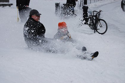A father and son enjoy the snow day