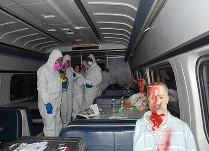 From the 2007 Penn Station Drill: Members of the Office of the Chief Medical Examiner enter a train car.