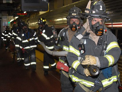 From the 2007 Penn Station Drill: Firefighters stretch a hose to extinguish the fire.
