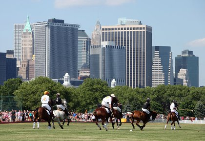 Prince Harry and others playing polo at Governors Island