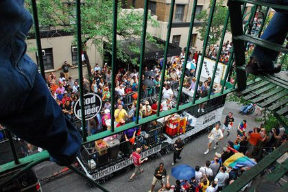 Viewing the parade on Christopher Street, from a fire escape