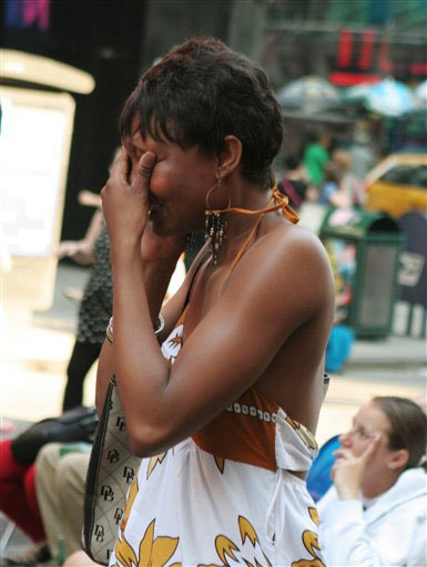A woman cries in Times Square.