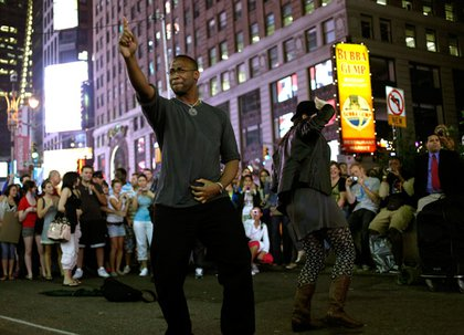 Pedestrians dance in tribute to Michael Jackson in Times Square.