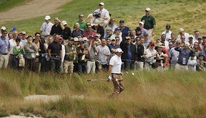 Phil Mickelson walks out of the rough on the 18th hole during a Wednesday practice round.