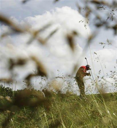 Ken Duke shot through the tall grass.