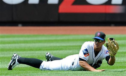 Center fielder Fernando Martinez makes the catch on Yadier Molina's sinking line drive