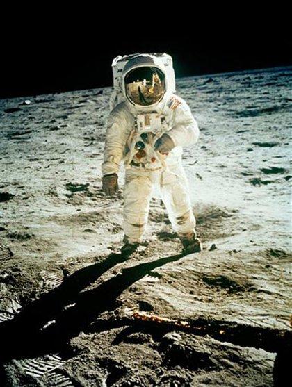Astronaut Edwin E. Aldrin Jr., lunar module pilot, is photographed by Neil Armstrong walking near the lunar module during the Apollo 11 extravehicular activity.