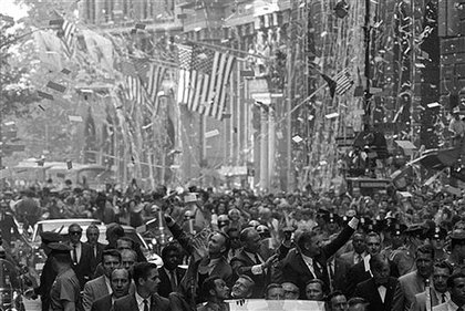 A ticker tape parade in lower Manhattan for, from left, astronauts Michael Collins, Edwin Aldrin, Jr., and Neil A. Armstrong, on  Aug. 13, 1969