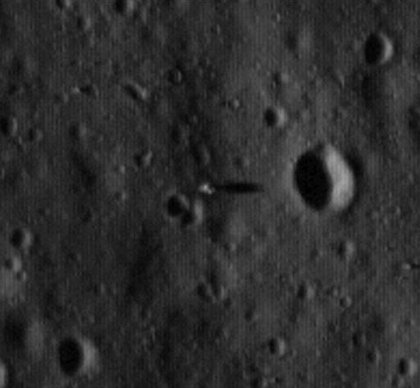 In this image provided by NASA Friday July 17, 2009 NASA's Lunar Reconnaissance Orbiter, has returned its first imagery of the Apollo moon landing sites. The picture shows the Apollo 11 missions' lunar module descent stage sitting on the moon's surface, center, as long shadow point towards the crater from a low sun angle make the modules' locations evident.