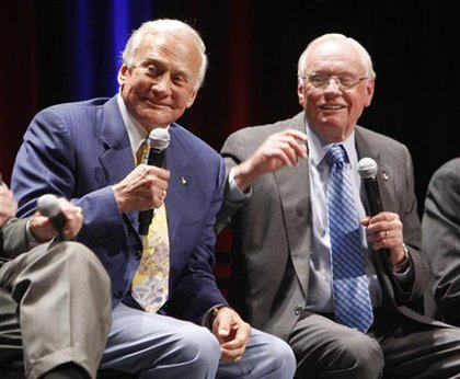 Buzz Aldrin, left, and Neil Armstrong, right, yesterday