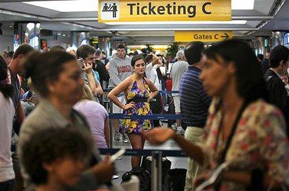 Travelers try to rebook their flights