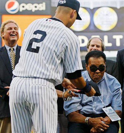 Derek Jeter present Ali with a fitted Yankees cap