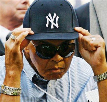 Ali adjusts the hat