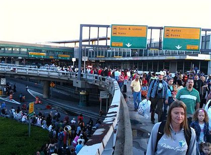Thwarted travelers leave the terminal