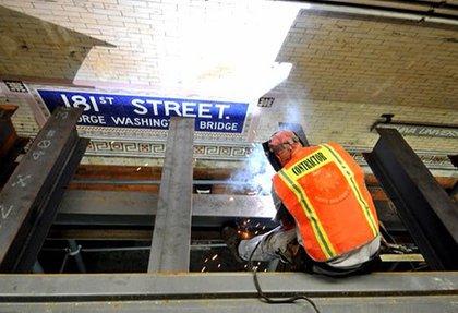 """181 St- welding barrier above the platform"""