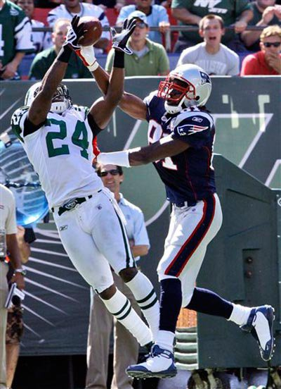 Darrelle Revis intercepts Patriots QB Tom Brady's intended pass for Randy Moss