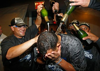 Melky Cabrera and other teammates douse Alex Rodriguez with champagne