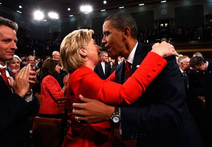 Secretary of State Hillary Clinton and President Obama embrace