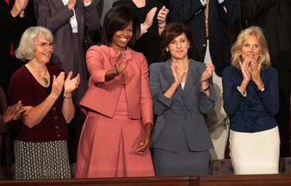 First Lady Michelle Obama waves, with, from left, Ellen Linderman of Carrington, N.D., Obama, Victoria Kennedy, wife of the late Sen. Edward Kennedy, D-Mass., and Jill Biden, wife of Vice President Joe Biden.