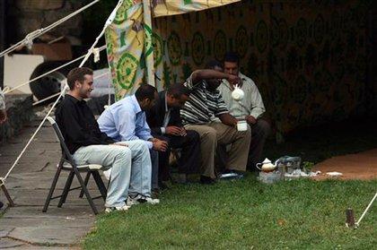 Gadhafi's workers, taking a break