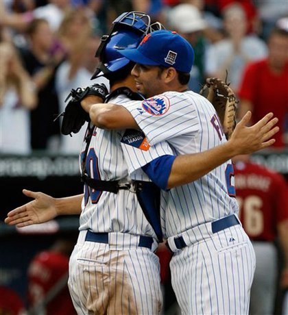 Nelson Figueroa (right) is congratulated by Josh Thole after pitching a complete shutout game