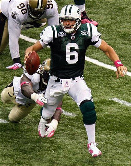 Mark Sanchez gets tripped by the Saints' Bobby McCray