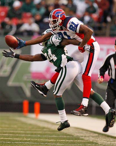 Darrelle Revis fights the Bills' Terrell Owens for the ball