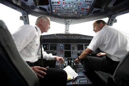 Captain Sullenberger and Skiles in the cockpit