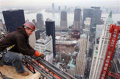 Lather Anthony Schuff ties off steel bars on the top floor of Beekman tower.