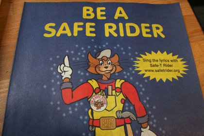 """and is on the cover of the """"Be A Safe Rider"""" coloring book."""