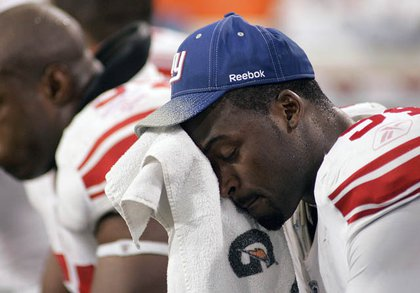 Mathias Kiwanuka sits on the bench during the 4th quarter.