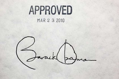 President Obama's signature—he used twenty pens to sign the bill.
