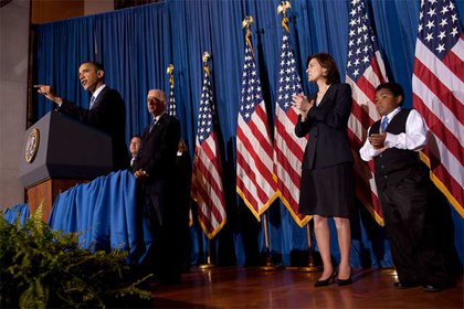 President Obama discusses health care reform with Vice President Joe Biden, Vicki Kennedy, wife of the late Sen. Edward Kennedy, and 11-year-old Marcelas Owens of Seattle, Washington behind him.  Owens' mother died in 2007 after she lost her job and insurance; he traveled to D.C. with his grandmother, who detailed the trip to the Seattle PI