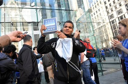 Luis Silva shows off his new iPad outside the Fifth Avenue store