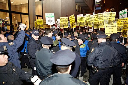 NYPD and protesters outside the MTA's final public hearing at FIT in Chelsea