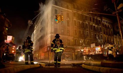 Photograph of firefighters outside the Chinatown blaze