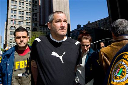 Federal agents escort Anthony Vechoione, a reputed member of the Gambino organized crime family, from Federal Plaza