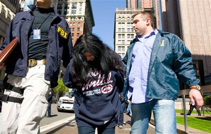 Federal agents escort Suzanne Porcelli, a reputed member of the Gambino organized crime family, from Federal Plaza