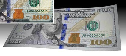 The bell and inkwell are both the same color on the new bill until tilted, when the bell changes from copper to green.