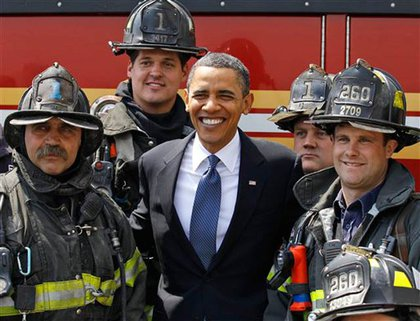 After his speech, and before flying out of town, Obama posed with firefighters of Rescue 1 and Engine 260
